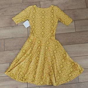 LuLaRoe Dresses - Lularoe yellow patterned Nicole dress size small